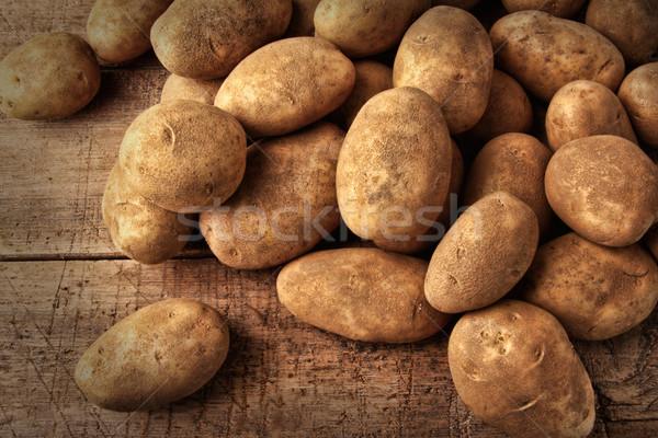 Fresh potatoes on wooden background  Stock photo © Sandralise