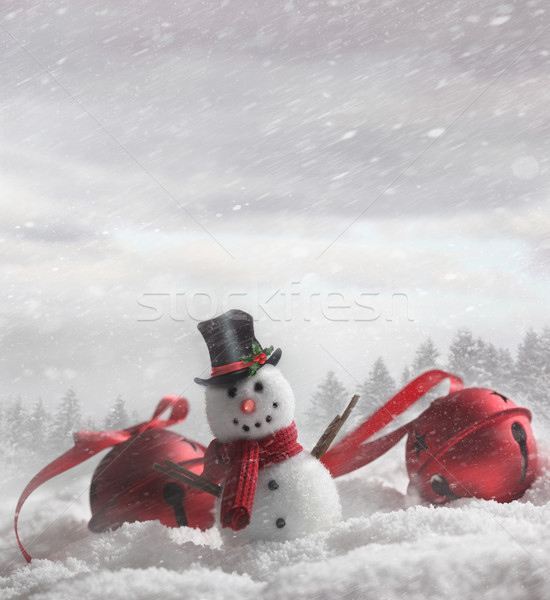 Snowman with bells in snowy background Stock photo © Sandralise