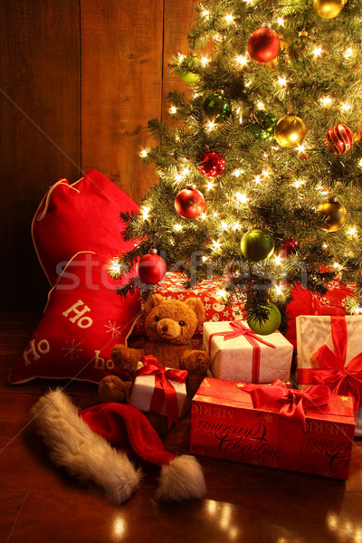 Brightly lit Christmas tree with gifts Stock photo © Sandralise