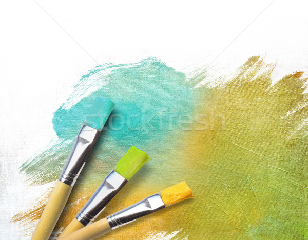 Artist brushes with a half finished painted canvas  Stock photo © Sandralise