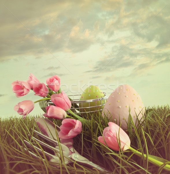 Fresh cut tulips with eggs in the tall grass Stock photo © Sandralise