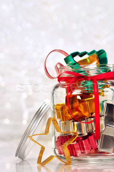 Colorful cookie cutters on holiday background Stock photo © Sandralise