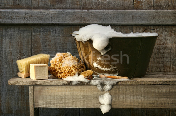 Old wash tub with soap on bench Stock photo © Sandralise