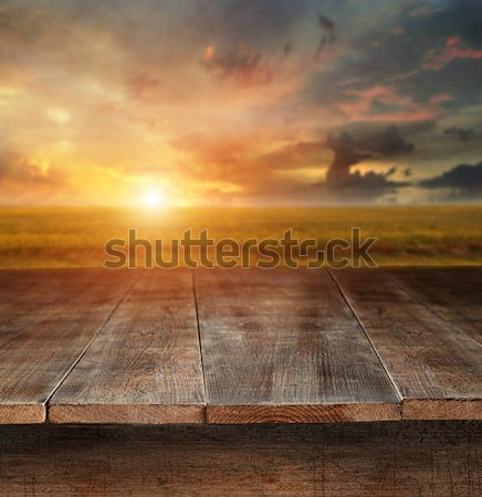Wooden table with rural scene in background Stock photo © Sandralise