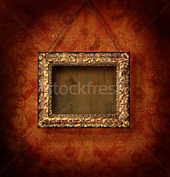 Golded picture frame on antique wallpaper Stock photo © Sandralise