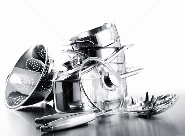 Pile of pots and pans against  white Stock photo © Sandralise