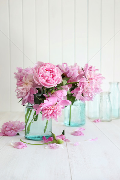 Pink peonies in glass jars  Stock photo © Sandralise