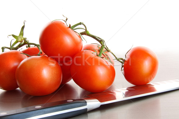 Stock photo: Fresh ripe tomatoes on stainless steel counter