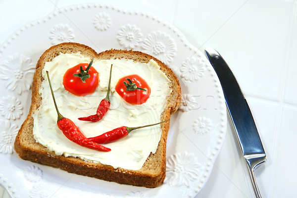 Food arranged into a smiley face on sandwich Stock photo © Sandralise