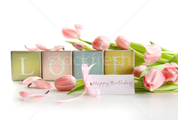 Stock photo: Wooden blocks with tulips and gift card