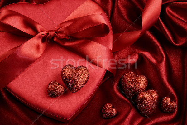 A group of red hearts on satin background Stock photo © Sandralise