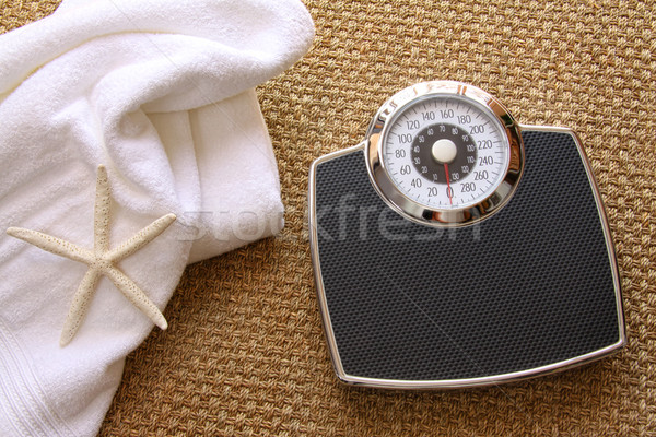 Weight scale with towel on carpet Stock photo © Sandralise