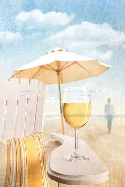 Stock photo: Glass of  wine on adirondack chair at the beach