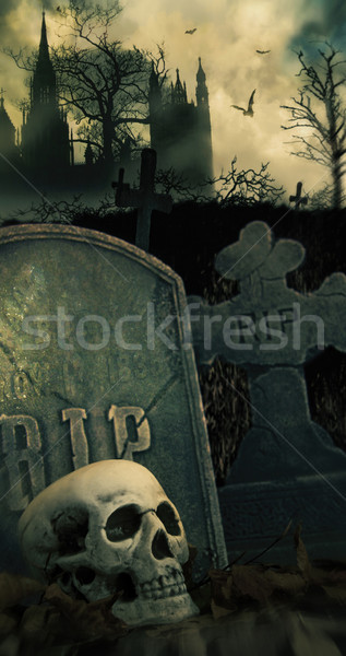 Stock photo: Night scene in graveyard with skull and graves