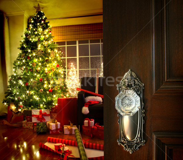 Door opening into a Christmas living room Stock photo © Sandralise