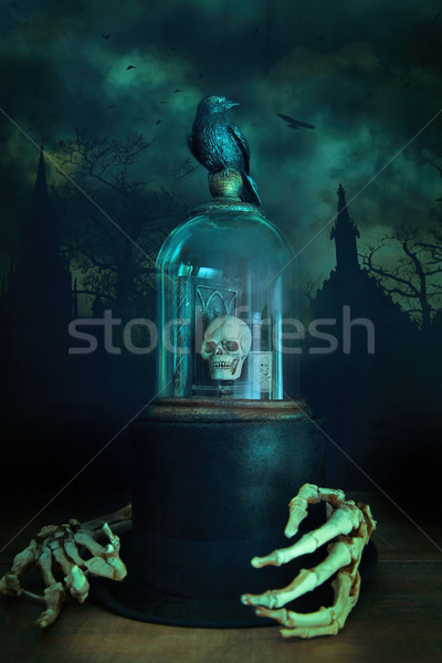 Glass bell jar with crow and skeleton hands Stock photo © Sandralise