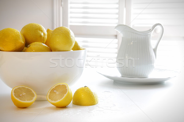 ストックフォト: レモン · ボウル · 表 · 台所用テーブル · フルーツ