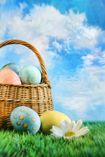Basket of easter eggs with a painterly effect Stock photo © Sandralise