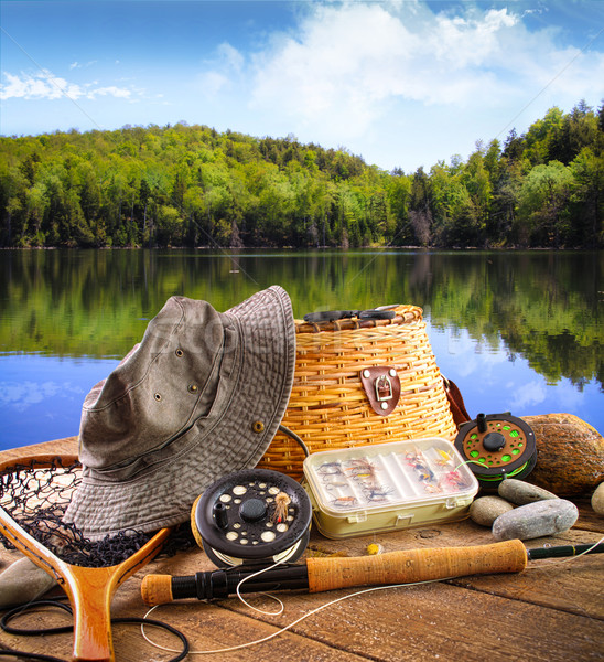 Fly fishing equipment  near a lake Stock photo © Sandralise