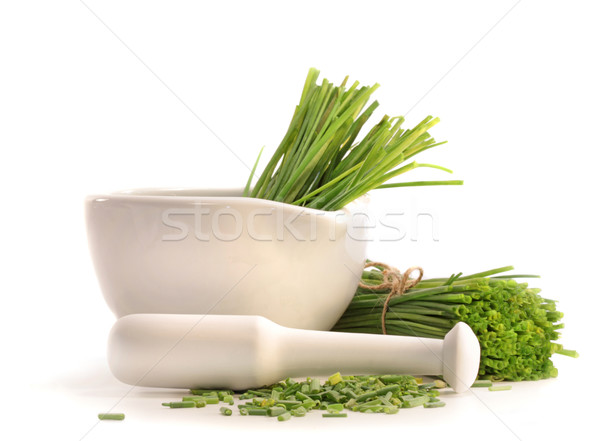 Fresh cut chives with a mortar and pestle Stock photo © Sandralise