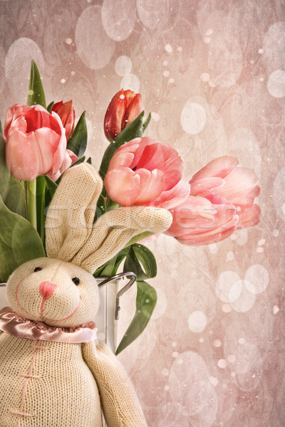 Stuffed rabbit with tulips for easter Stock photo © Sandralise