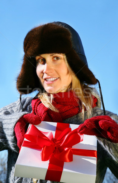 Woman presenting a Christmas gift Stock photo © Sandralise