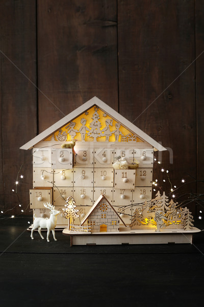Wooden holiday houses with lights Stock photo © Sandralise