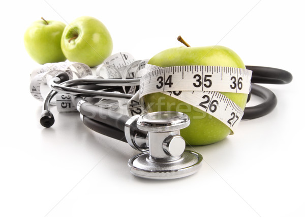 Stock photo: Green apples with stethoscope against white