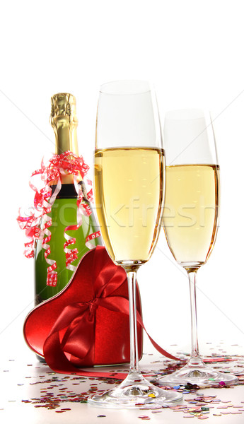 Stock photo: Glasses of champagne with red ribbon heart