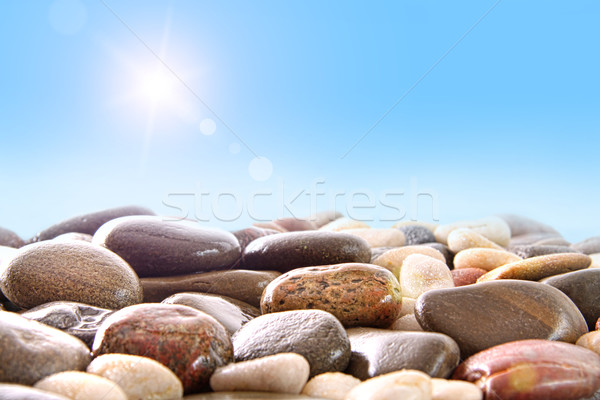 Pile of river rocks on white Stock photo © Sandralise