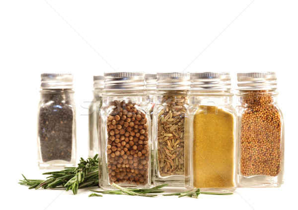 Spice jars with fresh rosmary leaves against white Stock photo © Sandralise