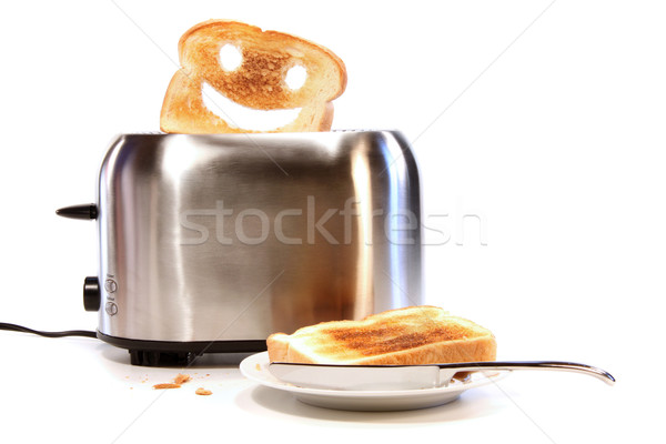 Toasted bread with toaster on white Stock photo © Sandralise