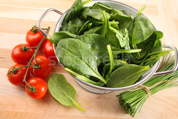 Strainer with spinach leaves and tomatoes Stock photo © Sandralise