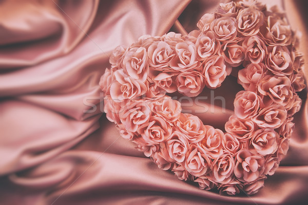 Heart made of pink roses on satin Stock photo © Sandralise