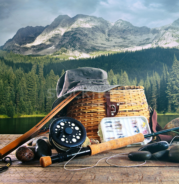 Fly fishing gear on wooden deck with lake  Stock photo © Sandralise