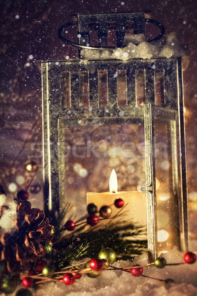 Brightly lit lantern in the snow Stock photo © Sandralise