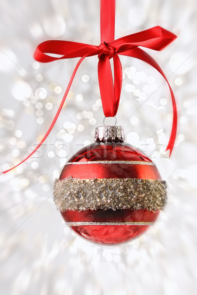 Red Christmas ball with ribbon on sparkly background Stock photo © Sandralise