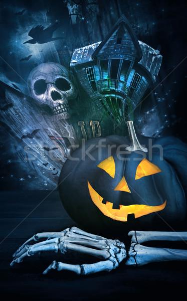 Black pumpkin with skeleton hand Stock photo © Sandralise