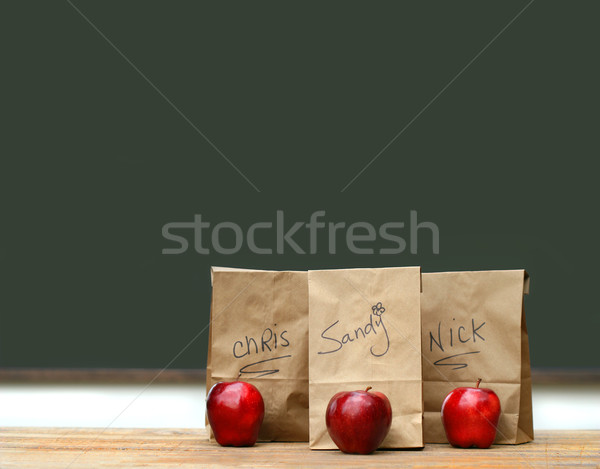Lunch bags on desk with red apples Stock photo © Sandralise