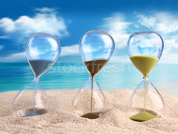 Three hourglass in the sand Stock photo © Sandralise