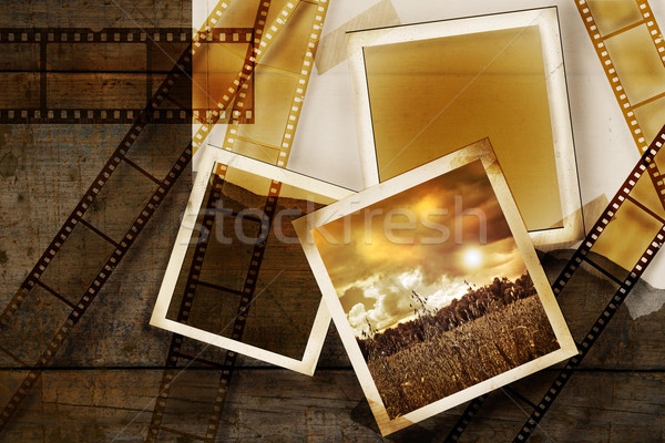 Old film and photos on distressed wood panels Stock photo © Sandralise