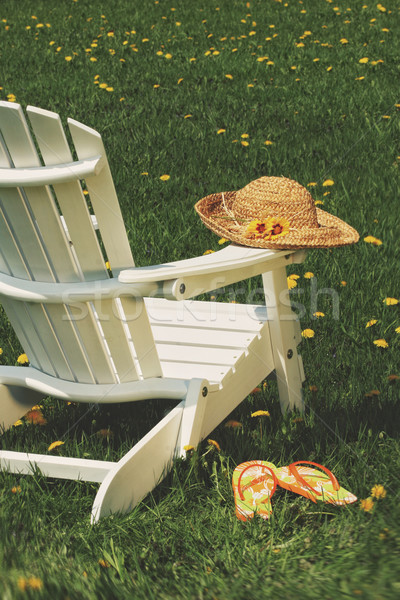 Straw hat on chair Stock photo © Sandralise