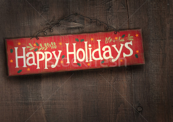 Holiday sign on distressed wood wall Stock photo © Sandralise