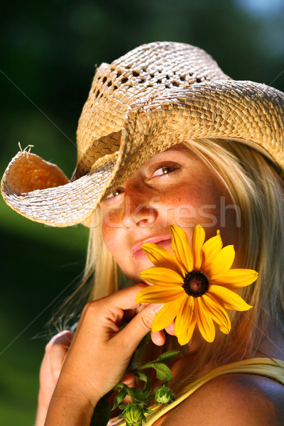 Young woman holding  daisy Stock photo © Sandralise