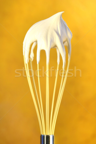 Whisk with whip cream on top Stock photo © Sandralise