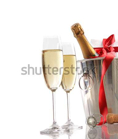 Champagne glasses with ice bucket on white Stock photo © Sandralise