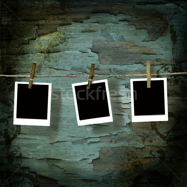 Blank instant camera pictures against old crackled backdrop Stock photo © Sandralise