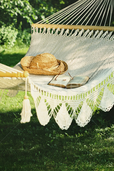 Crocheted hammock with straw hat and book Stock photo © Sandralise