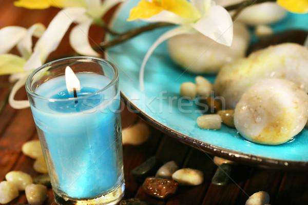 Blau Aromatherapie Kerze Steine spa Wasser Stock foto © Sandralise