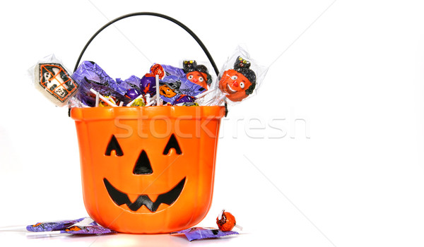 Jack-o-Lantern bucket filled with candies Stock photo © Sandralise